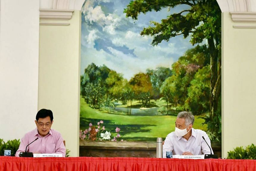 Prime Minister Lee Hsien Loong and Deputy Prime Minister Heng Swee Keat at a press conference at the Istana on April 8, 2021.