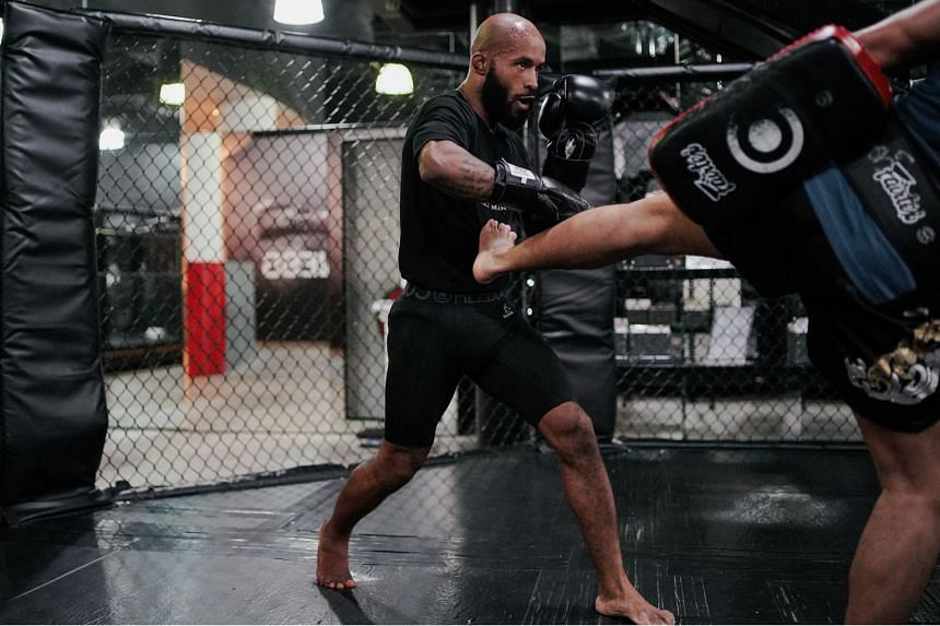 Former UFC flyweight champion Demetrious Johnson training in 2019. He and Eddie Alvarez are the headline acts in today's event. ST FILE PHOTO