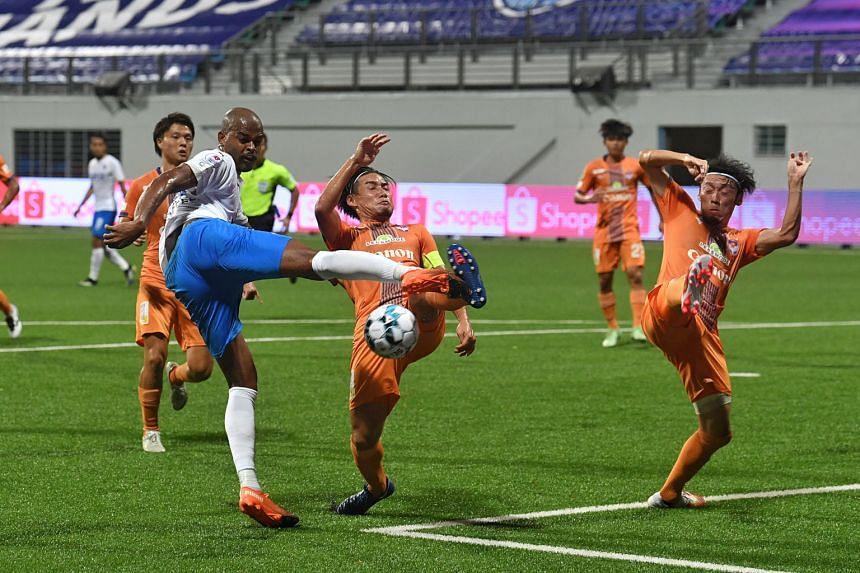Lion City's Brazilian defender Jorge Fellipe's shot is blocked by Albirex captain Kazuki Hashioka. The Sailors lost both games to the champions last season.