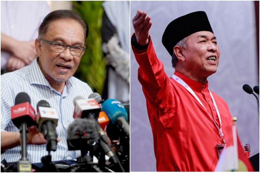 Malaysia's opposition leader Anwar Ibrahim (left) is under pressure from his Pakatan Harapan alliance not to work with tainted Umno leaders such as Zahid Hamidi.