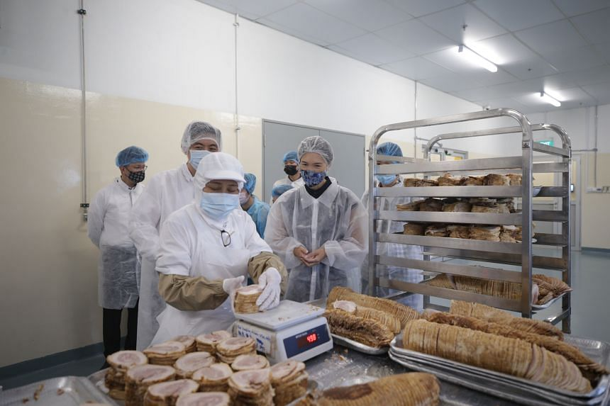 Manpower Minister Josephine Teo tours food manufacturing company Eurasia F&B on April 8, 2021.