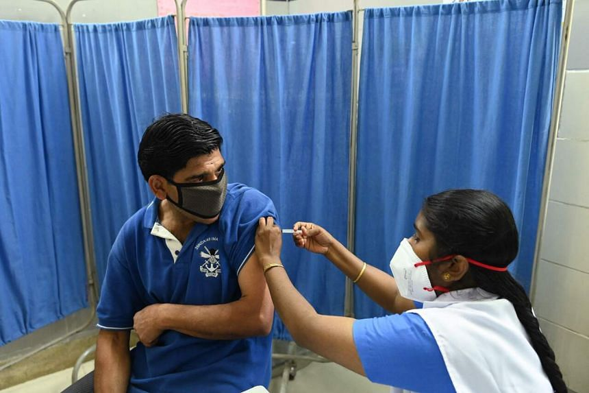 A medical worker administering the Covaxin Covid-19 vaccine at a health centre in New Delhi on April 6, 2021.