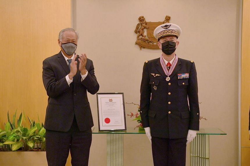 General Philippe Lavigne (right) was presented with the Meritorious Service Medal (Military) by Defence Minister Ng Eng Hen on April 8, 2021.