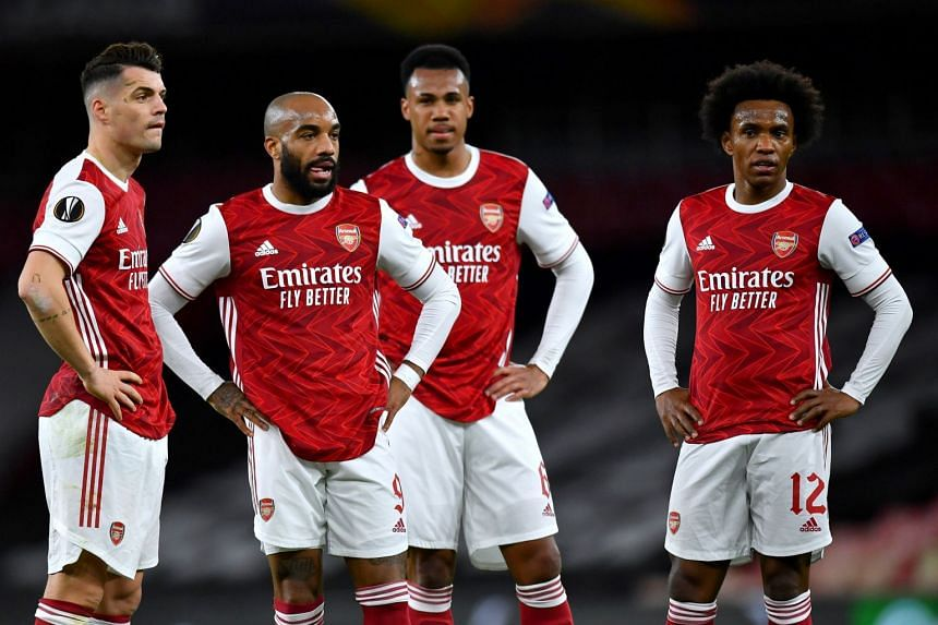 Arsenal's Granit Xhaka, Alexandre Lacazette, Gabriel Magalhaes and Willian react during the match.