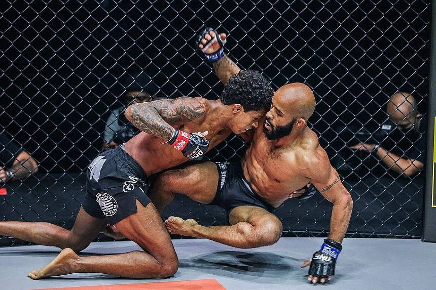 One Championship flyweight world champion Adriano Moraes (left) beat Demetrious Johnson at the One on TNT 1 event at the Singapore Indoor Stadium yesterday.