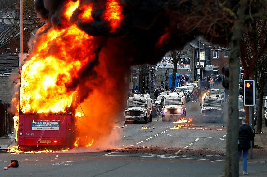 A bus set alight by protesters in Belfast, Northern Ireland, on Wednesday, extending a week of rioting that commentators have linked to fury among the pro-United Kingdom community at economic disruption caused by Britain's Brexit departure from the E