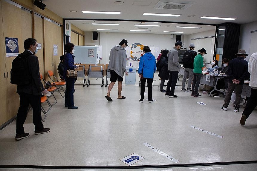 Voters at a polling station in Seoul, South Korea, on Wednesday. Comfortable victories by the opposition conservative People Power Party in the by-elections in Seoul and Busan deal a blow to Mr Moon Jae-in's progressive Democratic Party ahead of the