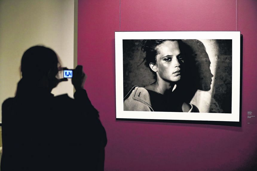 A portrait of British actress Kate Winslet by German photographer Peter Lindbergh is displayed as part of the exhibition - 2017. Pirelli Calendar By Peter Lindbergh And More - at modern art museum Erarta in St Petersburg, Russia. Swedish actress Alic