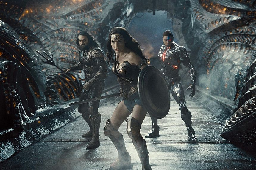 Director Joss Whedon allegedly threatened to harm the career of Gal Gadot (centre), who plays Wonder Woman in Justice League, after they clashed over his take on the movie.
