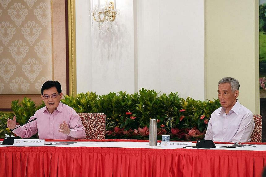 Deputy Prime Minister Heng Swee Keat and Prime Minister Lee Hsien Loong at the news conference at the Istana yesterday. Mr Heng said he made the decision to step aside as leader of the 4G team with the best interests of Singapore at heart, and PM Lee