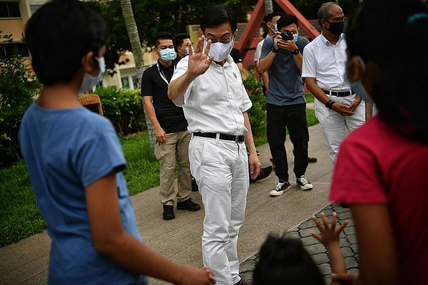 "Deputy Prime Minister Heng Swee Keat on the campaign trail last July. His move to East Coast GRC to helm the PAP's team there was a surprise that took place on Nomination Day. ""It was completely new ground for me and I did my best... When I went out"