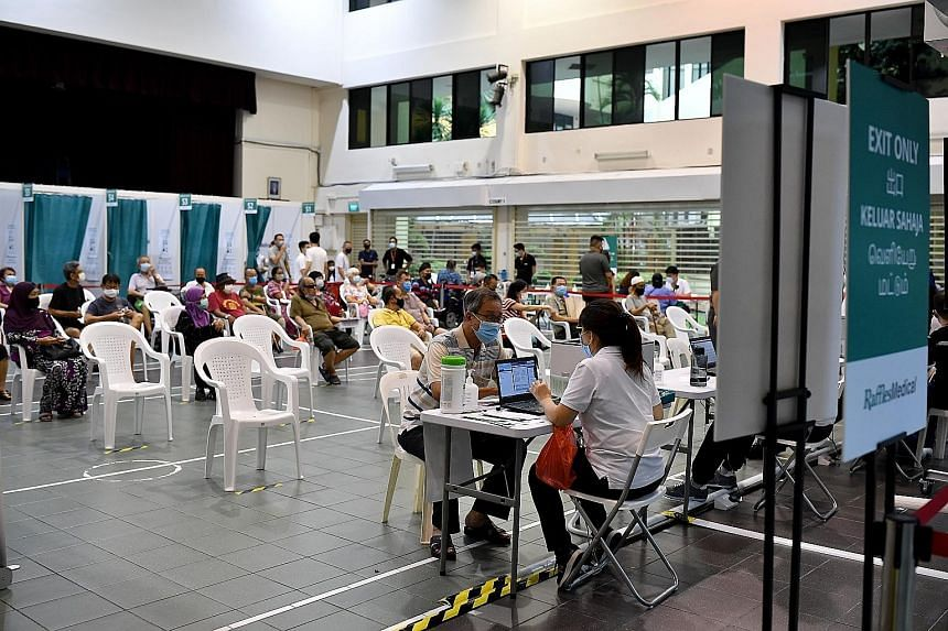 People at a Covid-19 vaccination centre in Hong Kah North Community Club last month. The swift global deployment of safe and effective vaccines remains the cornerstone in dealing with this public health crisis, says the writer.