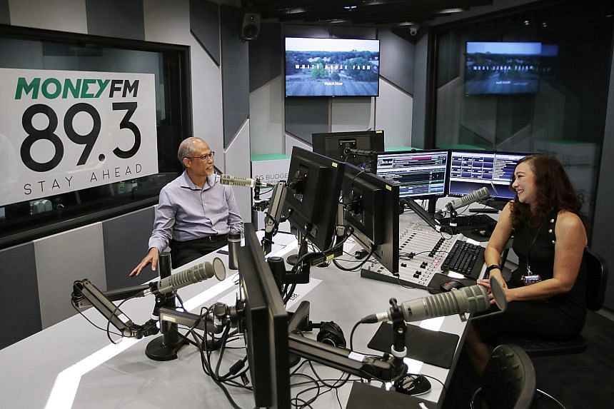Minister for Social and Family Development Masagos Zulkifli speaking with Money 89.3FM deejay Claressa Monteiro yesterday in a radio interview on financial help for Singaporeans impacted by Covid-19. ST PHOTO: GIN TAY