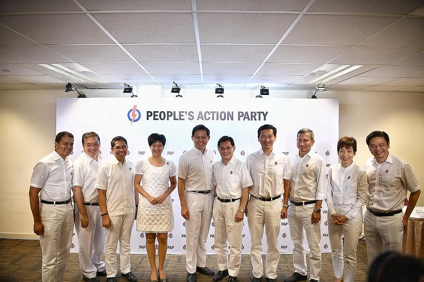 (From left) MPs Christopher de Souza and Sitoh Yih Pin, Ministers in the Prime Minister's Office Maliki Osman and Indranee Rajah, Trade and Industry Minister Chan Chun Sing, Deputy Prime Minister Heng Swee Keat, Transport Minister Ong Ye Kung, Foreig