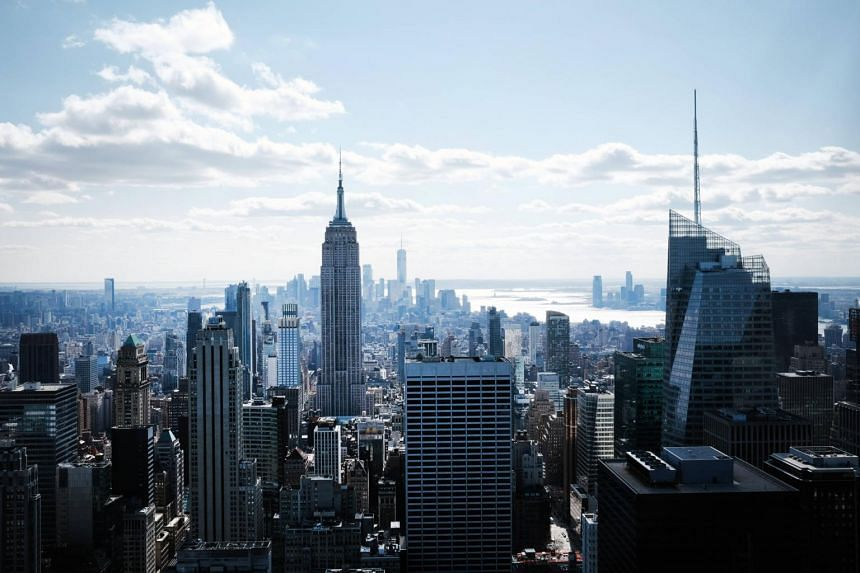 In only a year, the market value of office towers in Manhattan has plummeted 25 per cent.