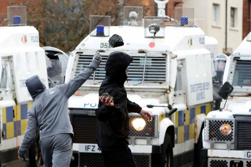 Nationalist youths attack police officers with rocks in the Springfield Road area of Belfast on April 8, 2021.