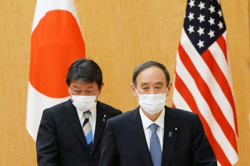 Japanese Prime Minister Yoshihide Suga (right) accompanying Japanese Foreign Minister Toshimitsu Motegi to attend a courtesy call by Antony Blinken, US Secretary of State and Lloyd Austin, US Secretary of Defense at the prime minister's official resi
