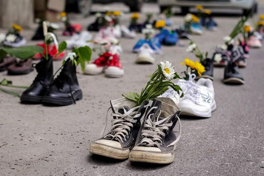 """Shoes being displayed with flowers in Mandalay, as part of the """"Marching Shoes Strike"""" called on social media to protest against the demonstration against the military coup in Myanmar on April 8, 2021."""