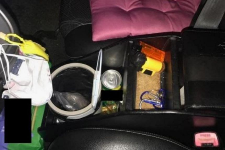 Improvised lighters and heroin seized from a 43-year-old Singaporean female's vehicle on April 5, 2021.