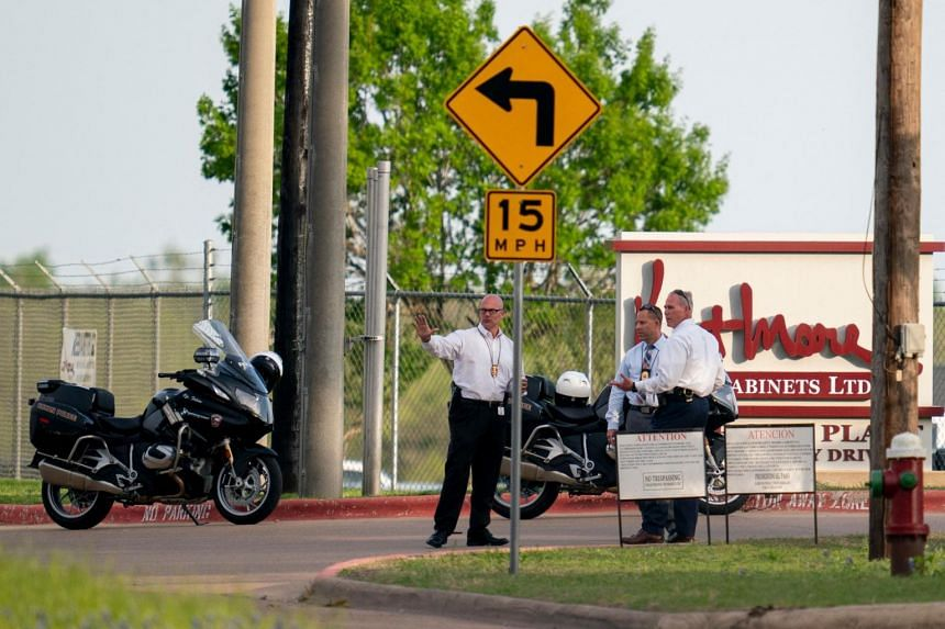 Bryan police officers work the scene of a mass shooting at Kent Moore Cabinets in Bryan, Texas on on April 8, 2021.