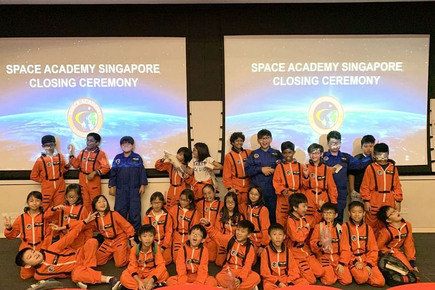 Above: The Space Academy Singapore Junior camp is conceptualised and organised by SSTL to encourage young people to take an interest in space. Right: SSTL co-founder and chief executive Lynette Tan says space technology has many applications.