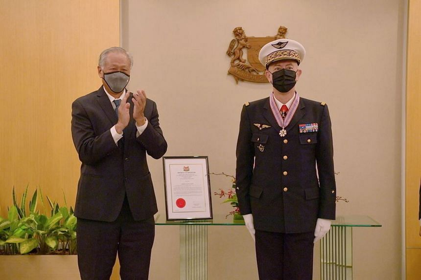 Defence Minister Ng Eng Hen with General Philippe Lavigne after presenting the Chief of Staff of the French Air and Space Force with the Meritorious Service Medal (Military) yesterday