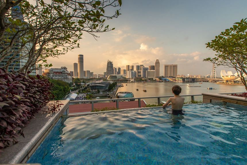 In a year of no tourists, hotels have found new ways to stay relevant, attracting a Singapore crowd itching to travel but happy to settle for the next best thing.