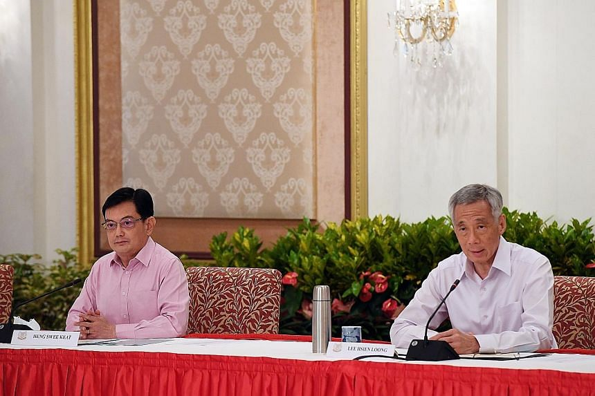Deputy Prime Minister Heng Swee Keat with Prime Minister Lee Hsien Loong at the news conference at the Istana on Thursday. The writer says he is confident that the new prime minister-designate will be supported by fellow Cabinet members and everyone