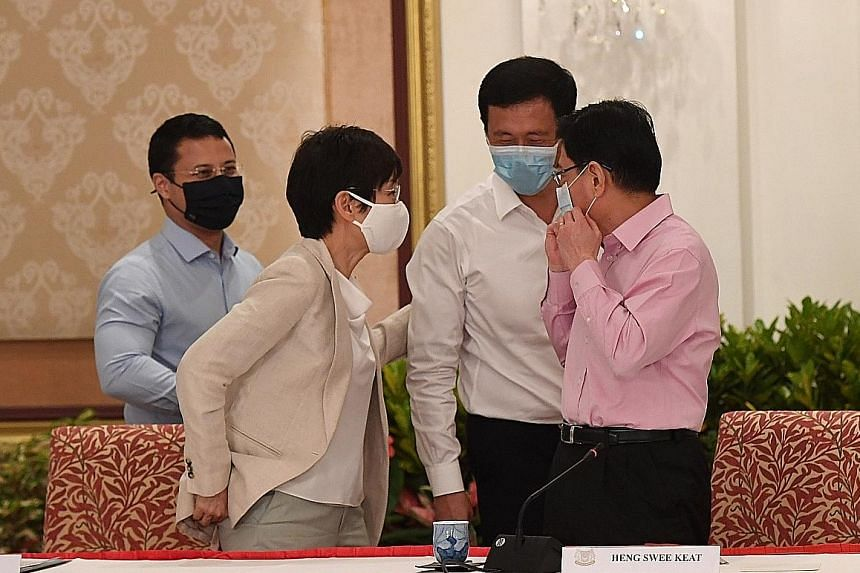 Deputy Prime Minister Heng Swee Keat with (from left) 4G ministers Desmond Lee, Grace Fu and Ong Ye Kung after the media conference on Thursday, where Mr Heng's decision to step aside as the leader of the 4G team was announced.