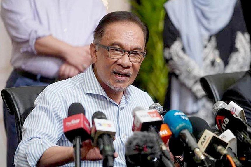 The Pakatan Harapan pact's decision for Mr Anwar Ibrahim to be its prime ministerial candidate comes amid the leak of a controversial audio clip purportedly of him speaking with Umno's president. PHOTO: PARTI KEADILAN RAKYAT