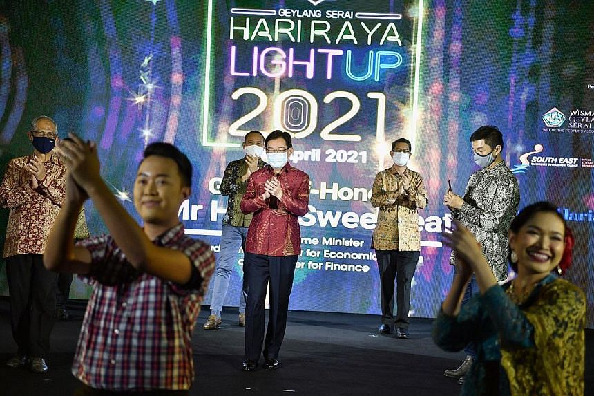 Above: This year's 40 light installations stretch along Sims Avenue starting at Paya Lebar Quarter, and Changi Road (above) and Geylang Road, starting at CharisTurf. Left: Deputy Prime Minister Heng Swee Keat at the light-up with (from left) Minister