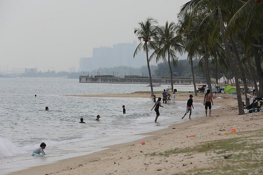 People enjoying the beach at East Coast Park last month. The coastal model will simulate potential changes in waves near the shore, as well as storm surges within the region. ST PHOTO: ONG WEE JIN
