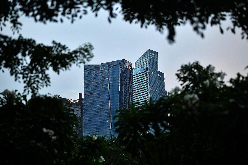 DBS is apparently set to surrender about 21/2 floors in Tower 3 of Marina Bay Financial Centre in December. Banks around the world are rethinking their use of offices after the pandemic popularised remote working. ST PHOTO: LIM YAOHUI