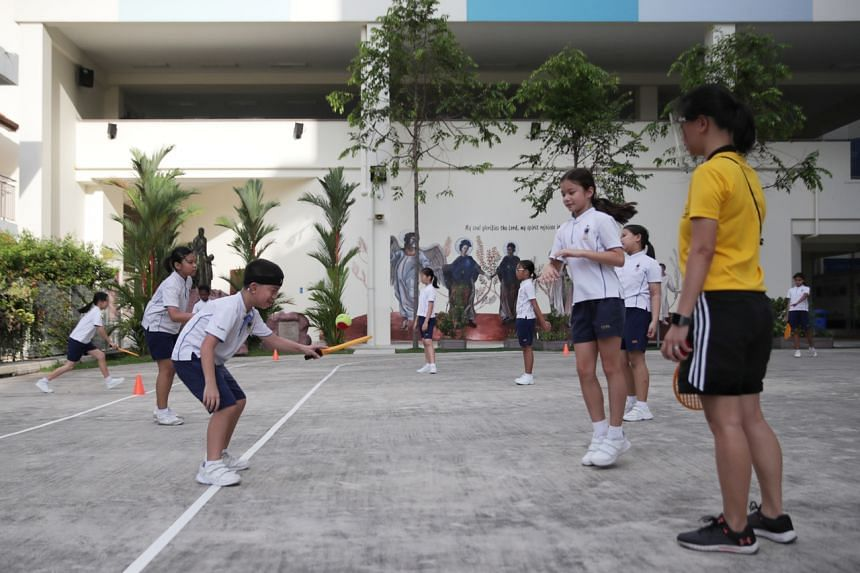 Pupils from Canossian School joining their mainstream peers at Canossa Catholic Primary School for a physical education class.