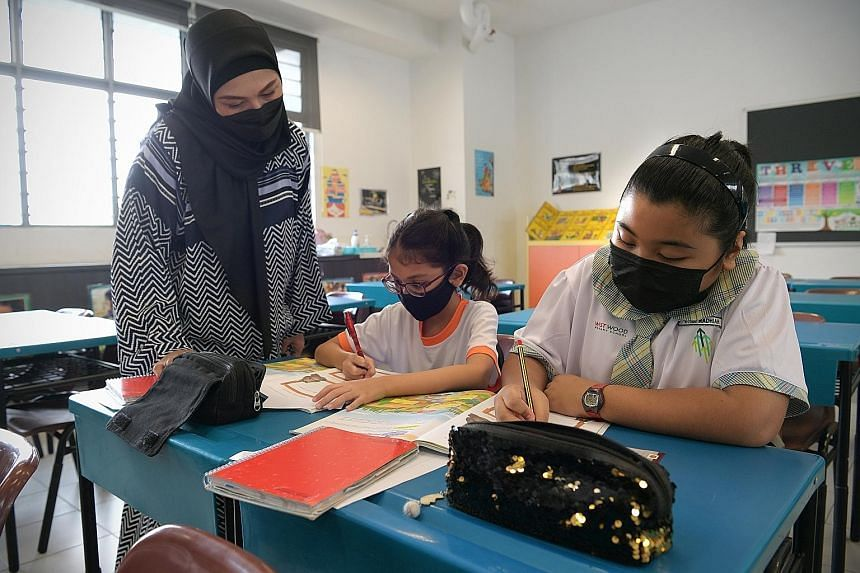 Malay language teacher Khaizuran Supa'at and her pupils during a Higher Malay lesson yesterday at Westwood Primary School.