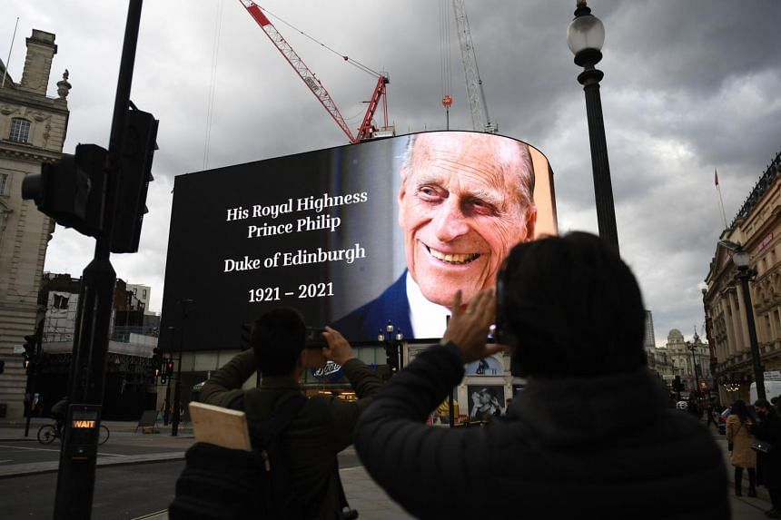 A giant picture of Britain's Prince Philip, Duke of Edinburgh, on display in London's Piccadilly Circus on April 9, 2021.