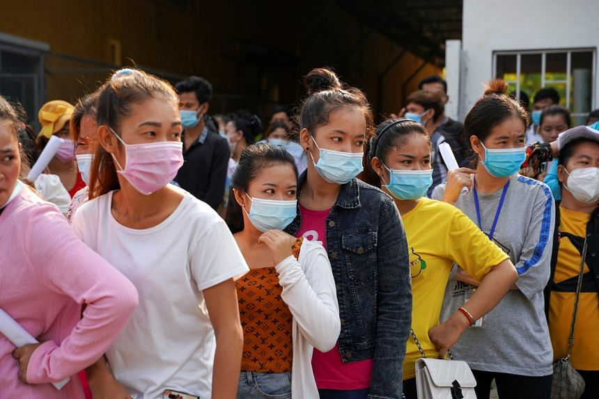 Garment factory workers wait to receive the vaccine at an industrial park in Phnom Penh, on April 7, 2021.