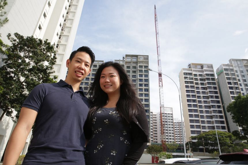 Ms Ellen Neo and her fiance Felix Lua in front of their Pine Vista BTO flat which is still under construction.