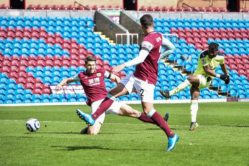 Newcastle's Allan Saint-Maximin (right) scores a goal against Burnley at Turf Moor on April 11, 2021.