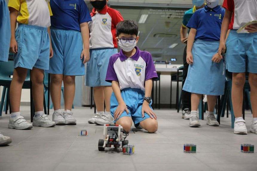 Northland Primary pupil Leroy Wong at a robotics CCA session. The school has resumed face-to-face sessions for all CCAs.