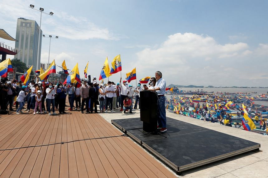 Ecuador's presidential candidate Guillermo Lasso speaks during a closing campaign rally in Guayaquil, Ecuador, on April 8, 2021.
