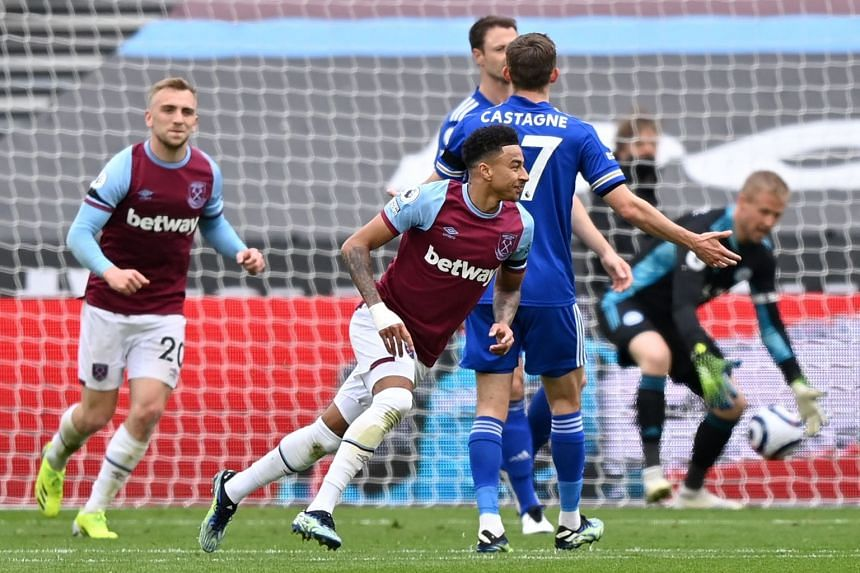 West Ham United's Jesse Lingard (centre) celebrates after scoring the opening goal against Leicester City on April 11, 2021.