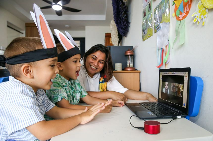 (From left) Douglas and Duncan Cain and their mother, Mrs Veronica Cain, starting a Zoom call with Ms Selma Alkaff, who presented an Easter-themed storytelling session that included a scavenger hunt for the children.