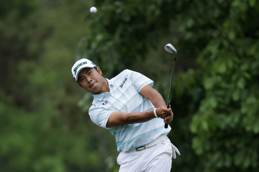 Japan's Hideki Matsuyama chips onto the 14th green during the third round in Augusta National Golf Club, Georgia, on April 10, 2021.