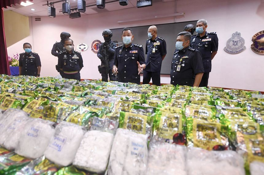 Malaysia's national police chief, Tan Sri Abdul Hamid Bador (centre), at a media conference to announce a drug seizure on March 22, 2021.