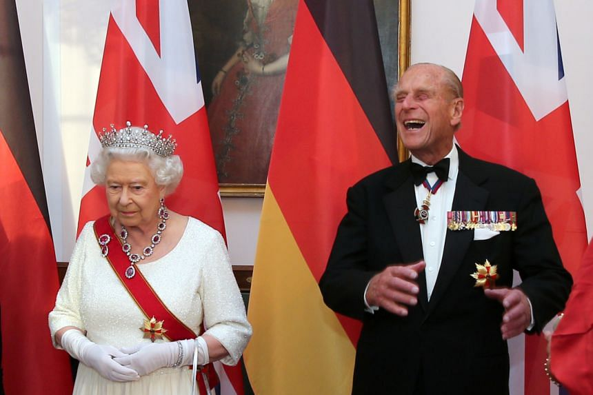In a photo taken on June 24, 2015, Queen Elizabeth and Prince Philip wait to greet guests prior to a state banquet in Berlin, Germany.