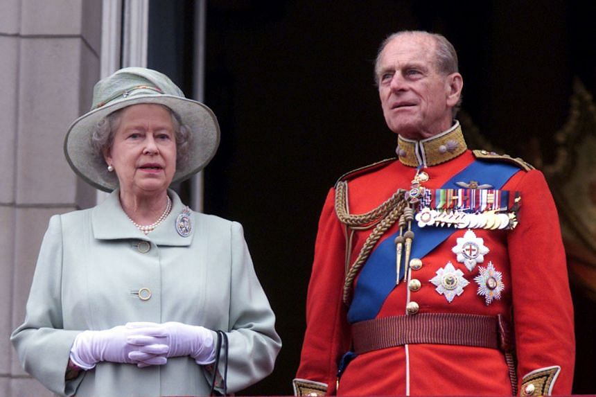 In a photo taken on June 16, 2001, Queen Elizabeth and Prince Philip stand on a balcony at Buckingham Palace for the Trooping the Colour ceremony.