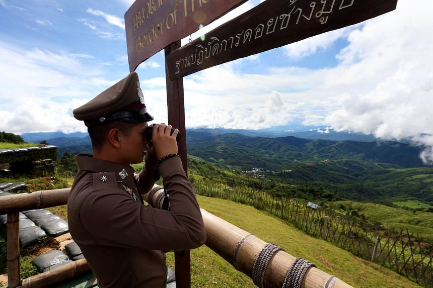 A Thai police officer in October 2019 surveying the vast landscape near the Thai-Myanmar border, where meth smugglers are known to infiltrate the porous Thai border.