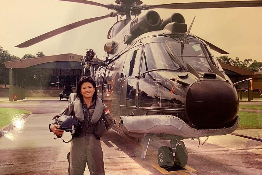 Ms Poh Li San, pictured with a Super Puma circa 2005, counts being deployed for humanitarian aid and disaster relief in the 2004 Boxing Day tsunami aftermath as one of the highlights of her air force career. Mr Robert Tan, seen on his last Super Puma