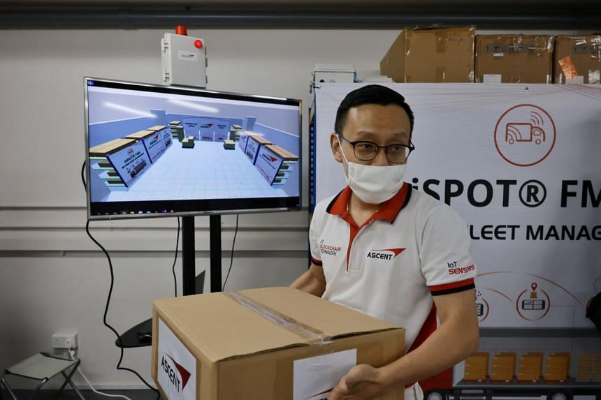 Ascent Solutions corporate strategy head Huang Yihang demonstrating the company's warehouse cargo tracking system on April 12, 2021.